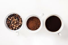 Many cups of coffee on white background Royalty Free Stock Images