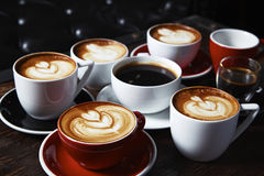Many cups of coffee on wooden table, top view Royalty Free Stock Photo