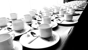 Many cups on a long table. Cups are prepared for service Royalty Free Stock Photos