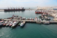 Many cutters at its mooring in port. People on their cutters. big ship Royalty Free Stock Photography