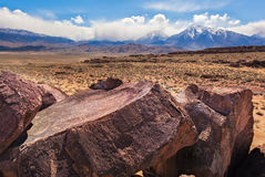 Many Days, Sky Rock. Sky Rock in the Eastern Sierras of California is a five thousand year old petroglyph and is one of two on the planet which face straight up Stock Images