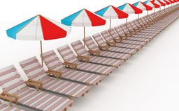 Many deck-chairs with parasols Stock Images