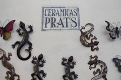 Many decorative lizards and butterflies. Made with metal and ceramic tiles on a wall in Ibiza Royalty Free Stock Images