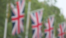 Many defocussed Union Jack flags background copy space Stock Photos