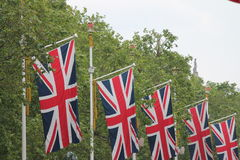 Many defocussed Union Jack flags background copy space Royalty Free Stock Photography