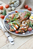 Many delicious bruschetta with cheese, tomato, quail egg, ham Stock Photos