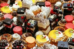 Many delicious cakes and cupcakes on table at luxury wedding rec. Eption, catering in restaurant stock images