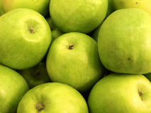 Many delicious ripe green apples Stock Image