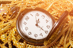 Many design gold jewelry and pocket watch. Group of many design gold jewelry and pocket watch Royalty Free Stock Image
