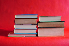 Many different books are on a red  background Royalty Free Stock Photo