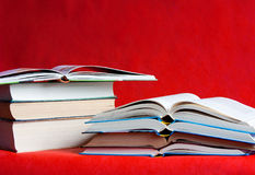 Many different books are on a red  background Royalty Free Stock Images