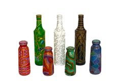 Many different bottles, painted dot painted on isolated background. royalty free stock image