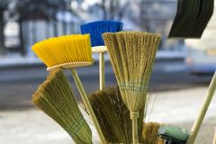 Many different brooms and floor brushes for sale.  Royalty Free Stock Photo