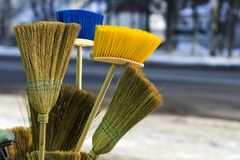 Many different brooms and floor brushes for sale.  Royalty Free Stock Images