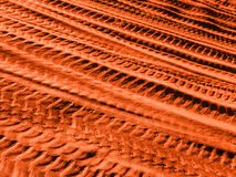Different car tracks on the red sand. stock image