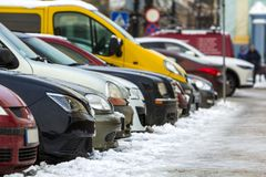 Many different cars parked in a city. Cars for sale stock photo