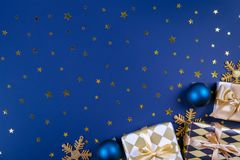Many different christmas and new years presents in colorful wrapping stock image