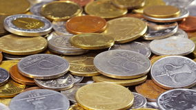 Many different coins collection background rotating stock footage