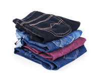 Many different colored jeans Stock Images