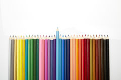 Many different colored pencils on white backgroun Stock Photo