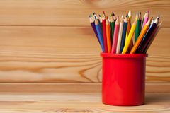 Many different colored pencils on wooden table Stock Photos