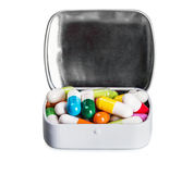 Many different colored pills isolated on white Stock Image