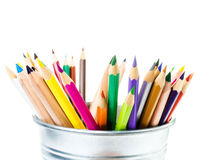 Many different colored Rainbow pencils school supplies in tin bo Royalty Free Stock Images