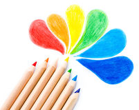 Many different colored Rainbow pencils school supplies  on white. Background close up Stock Photos