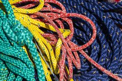 Many different colored ropes together royalty free stock photo