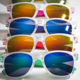 Many different colorful sunglasses in a row isolated on a white background Stock Images