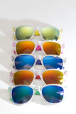 Many different colorful sunglasses in a row isolated on a white background Stock Image