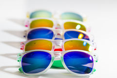Many different colorful sunglasses in a row isolated on a white background Royalty Free Stock Photos
