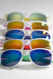 Many different colorful sunglasses in a row isolated on a white background Stock Photos