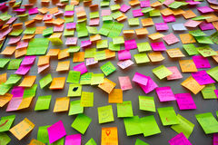 Many different colors paper notes. On the wall Stock Photo