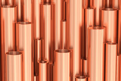 Many different copper pipes background. Metallurgical industry production and non-ferrous industrial products abstract illustration - many different various Stock Photo