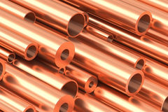 Many different copper pipes closeup. Metallurgical industry production and non-ferrous industrial products abstract illustration - many different various sized Stock Images
