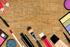 Many different cosmetics over wooden Royalty Free Stock Images