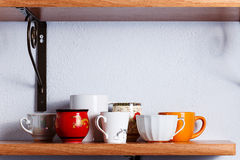 Many different cups. Are on the shelf Royalty Free Stock Photo