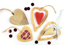 Many different decorative hearts on wood . royalty free stock photo