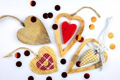 Many different decorative hearts on wood . stock photography