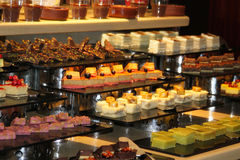 Many different desserts. A lot of delicious chocolate desserts, fruit, nuts and fruit royalty free stock photography