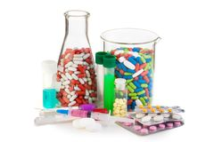 Many different drugs and tablets in laboratory glassware Stock Photography