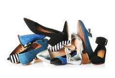 Many different female shoes. On white background royalty free stock image