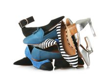 Many different female shoes. On white background stock image