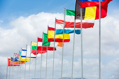 Many different flags waving on the wind. In sunny day Stock Photo
