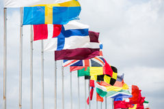 Many different flags waving on the wind Royalty Free Stock Image