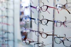 Many different glasses displayed at optician in store Stock Images