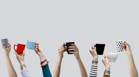 Many different hands holding coffee cups. Close up stock photography