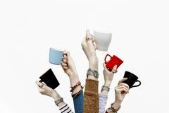 Many different hands holding coffee cups on isolated white background. Copy space royalty free stock photos