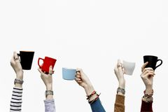Many different hands holding coffee cups on isolated white background. Copy space royalty free stock image